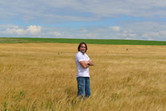 Man stands on the rye field Stock Photo
