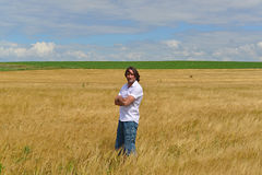 Man stands on the rye field Royalty Free Stock Image