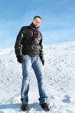 Man stands on snow by winter day Royalty Free Stock Photos