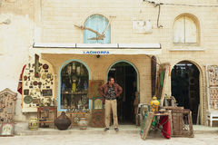 Man stands in at the souvenir shop entrance in El Djem, Tunisia. Royalty Free Stock Photos