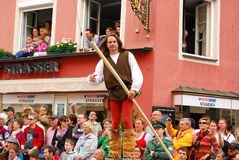 Man stands on stilts during Landshut weddings Royalty Free Stock Images