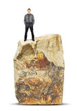 Man stands on the top of a huge rock Stock Photography