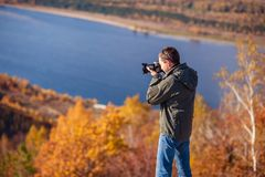 Man takes pictures of the landscape Stock Photos