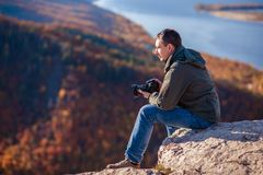 Man takes pictures of the landscape Royalty Free Stock Image