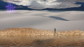 Man stands before vast desert. Landscape Royalty Free Stock Images