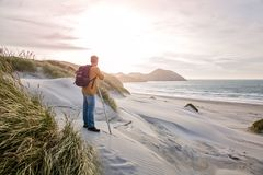Man Stands on White Sand Beach royalty free stock photo
