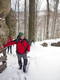A man stands in the winter forest. Stock Photo