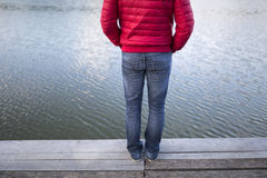 Man stands on the wooden pier Stock Image