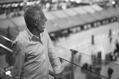 Man staring at the airport crowd downstairs Royalty Free Stock Photos