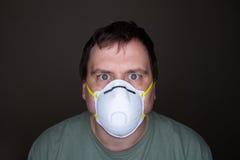 Man staring at the camera wearing his mask Stock Photo