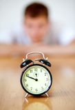 Man staring at a clock Royalty Free Stock Photography