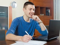 Man  staring financial documents at table Stock Photos