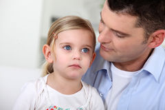 Man staring at his daughter Stock Photo