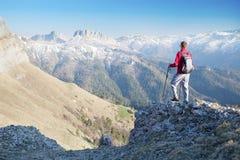 Man staring at the mountains. Traveler staring at the mountains Stock Photos