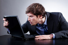 Man staring at screen. Of his laptop with anxiety Stock Photography