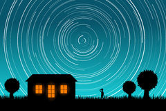 Man Staring at Star Trails in the Night Sky. EPS10 Vector Stock Photo