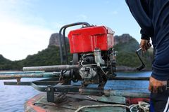 Man Start The Diesel Engine Of Long-tail Boat In Thailand. Royalty Free Stock Photo