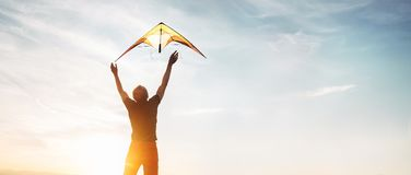 Free Man Start To Fly A Kite In The Sky Royalty Free Stock Photo - 123687665