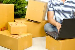 Man starter business with online eCommerce. Prepare many carton box to shipping to his customer Royalty Free Stock Images