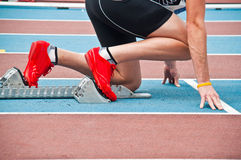 Man in a starting block Royalty Free Stock Image