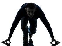 Man on starting blocks silhouette full length Stock Photography