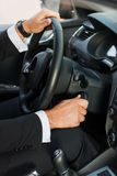 Man starting a car. Royalty Free Stock Image
