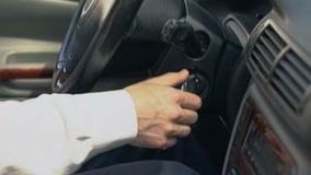 Man starting car, shifting gear, chauffeur driving for client, taxi service. Stock footage stock footage