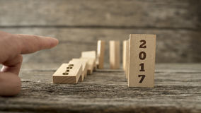 Man starting the domino effect from 2016 to 2017 Royalty Free Stock Image