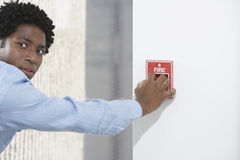 Man Starting Fire Alarm Stock Images