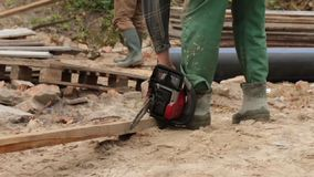 Man Starts A Chainsaw stock footage