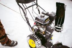 Man starts engine snow blower. Man starts the engine snow blower stock photos