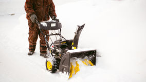 Man starts engine snow blower. Man starts the engine snow blower royalty free stock images