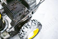 Man starts engine snow blower. Man starts the engine snow blower royalty free stock photos