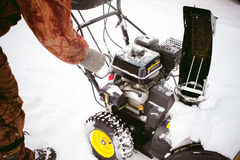 Man starts engine snow blower Stock Images