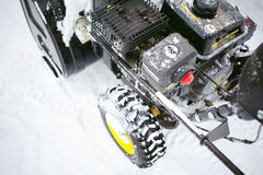 Man starts engine snow blower Royalty Free Stock Photography