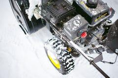 Man starts engine snow blower. Man starts the engine snow blower royalty free stock photography