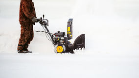 Man starts engine snow blower Royalty Free Stock Images