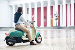 Man starts his scooter ready to drive Stock Photography