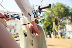 Man starts his scooter ready to drive Stock Image