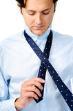 Man starts to tying his tie Royalty Free Stock Photography