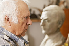 Man and statue Royalty Free Stock Image
