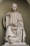 Man statue in the front of Florence Cathedral. Florence cathedral and one of its statues, vertically oriented, in white marble Royalty Free Stock Photography