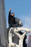 Man on statue of Republic in Paris. Stock Image