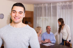 Man staying near family members Royalty Free Stock Photos