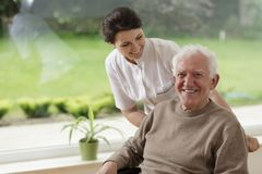 Man staying in nursing home. Smiling senior men staying in nursing home Stock Images