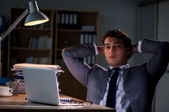 The man staying in the office for long hours Stock Photography