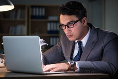The man staying in the office for long hours Stock Image