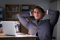 The man staying in the office for long hours Stock Images
