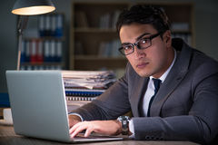 The man staying in the office for long hours Royalty Free Stock Photo