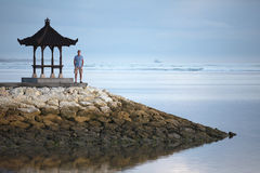 Man is staying on the pier in Indonesia Stock Photography